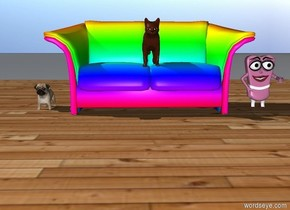 The dog is on the left of the rainbow couch. The small girl is on the right of the couch. There is a wood floor under the couch. There is a cat on the couch.