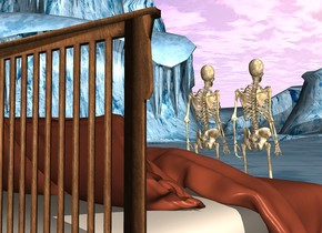 There are two skeletons. There is a bed behind the skeletons