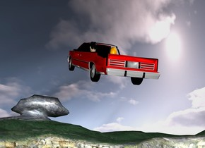 the ground. a  red car is 35 feet above the ground. it leans back. 1st tan head is -3.8 feet above and -7 feet behind and -1.4 feet right of the car. 2nd orange head is  1.3 feet left of the 1st head. the hair of the 1st head is black.