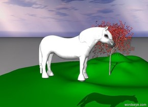 The brown horse is on the green hills near a big red maple tree.
