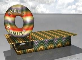 A donut shop.The donut shop has a [rainbow] texture.