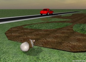 the humongous flat dirt alien is face up. the ground is grass. the eye of the alien is grass. the road is -8 feet to the right of the alien. It is 200 feet long. it is morning. The red car is on the road. The large Guinea pig is behind the alien.