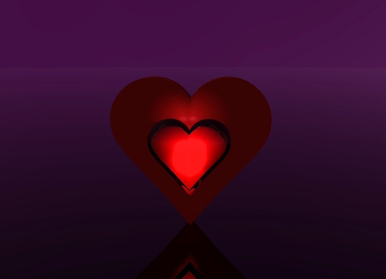 Input text: 1st enormous transparent red heart is 9 feet above the ground.. 5 pink lights are 4 inches behind the heart and 17 feet above the ground. the camera light is black. the sun is invisible. the sky is purple. the ground is clear. 2nd very enormous heart is 7 inches behind the 5 lights and on the ground. 3 dim plum lights are 2 inches above the 1st heart
