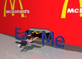 """There is a giant hotdog.  In front of the hotdog is a Sea Blue """"Eat Me"""".  In front of """"Eat Me"""" is a small man facing North.  Behind the hotdog is a [Maccas] wall."""