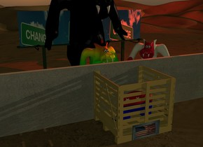 the small republican elephant is in a big box.  the long concrete wall is in front of the box.   the rainbow monster is 2 feet in front of the wall. it is facing the box. the mexican monster is next to the monster. it is facing the box. it is dusk. the red light is above the monster. the third monster is 4 feet in front of the wall. it is facing the box. it is tall and black. the american flag is behind the box. the [change] billboard is 9 feet in front of the wall. it is facing the box. the camera light is dark.