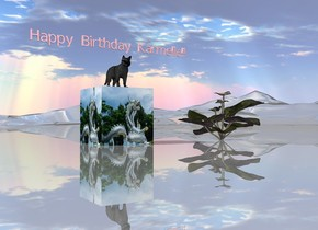 """The large [paint] cube is on the shiny mountain range. The cat is on the cube. The very small pink """"Happy Birthday Karmelle!!"""" is a few inches above the cat. A very large van gogh flower is a couple feet to the right of the cube."""