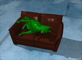 a green dog lies on a couch