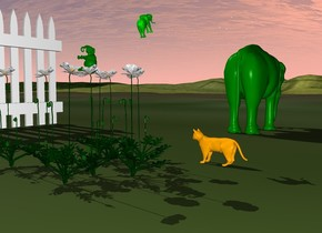the solid green elephant is 1.5 inches in the group. it is 4 inches tall. it is leaning 90 degrees to the back. the white fence is 5 feet to the left of the group. it is facing right.   a second green elephant is 1 foot behind and 3 inches above the elephant. it is 4 inches tall. it is facing back. it is leaning 30 degrees to the back. the small orange cat is  behind and -6 inches to the right of the group. it is facing the second elephant. the ground is grass.  the third solid green elephant is 4 feet behind the group. it is facing back. it is 2.5 feet tall.