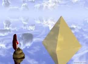 the enormous kidney is several inches in front of the very large poop. kidney is facing left. the ground is silver. the enormous gold pyramid is 10 feet to the left of the kidney.
