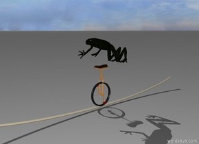 the frog is on top of the unicycle