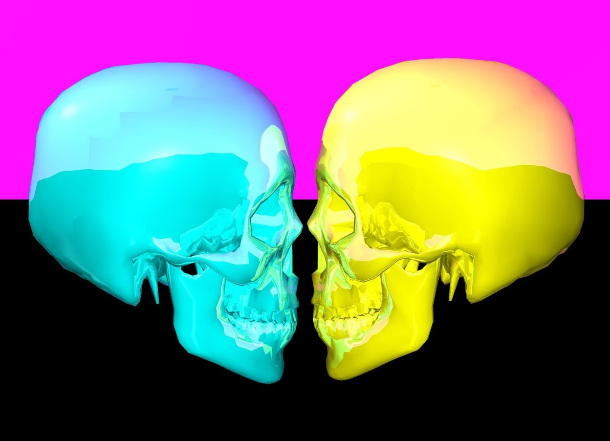 Input text: the sky is magenta. the ground is black. there is a shiny cyan skull facing east. there is a shiny yellow skull facing west. it is to the right of the shiny cyan skull.