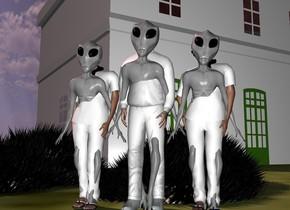 a man.a first 6 feet tall alien is -6 feet above the man.the man is white.a first woman is right of the man.a second 5.5 feet tall alien is -5.5 feet above the first woman.the first woman is white.a second woman is left of the man.the second woman is white.a third 5.5 feet tall alien is -5.5 feet above the second women.a building is 30 feet behind the man.the building is facing southwest.the building is grey.a first 10 feet tall hedgehog is behind the man.the first hedgehog is 6 feet in the ground.a second 10 feet tall hedgehog is left of the first hedgehog.the ground is field.the sun is pink.a white light is 2 feet in front of the building.