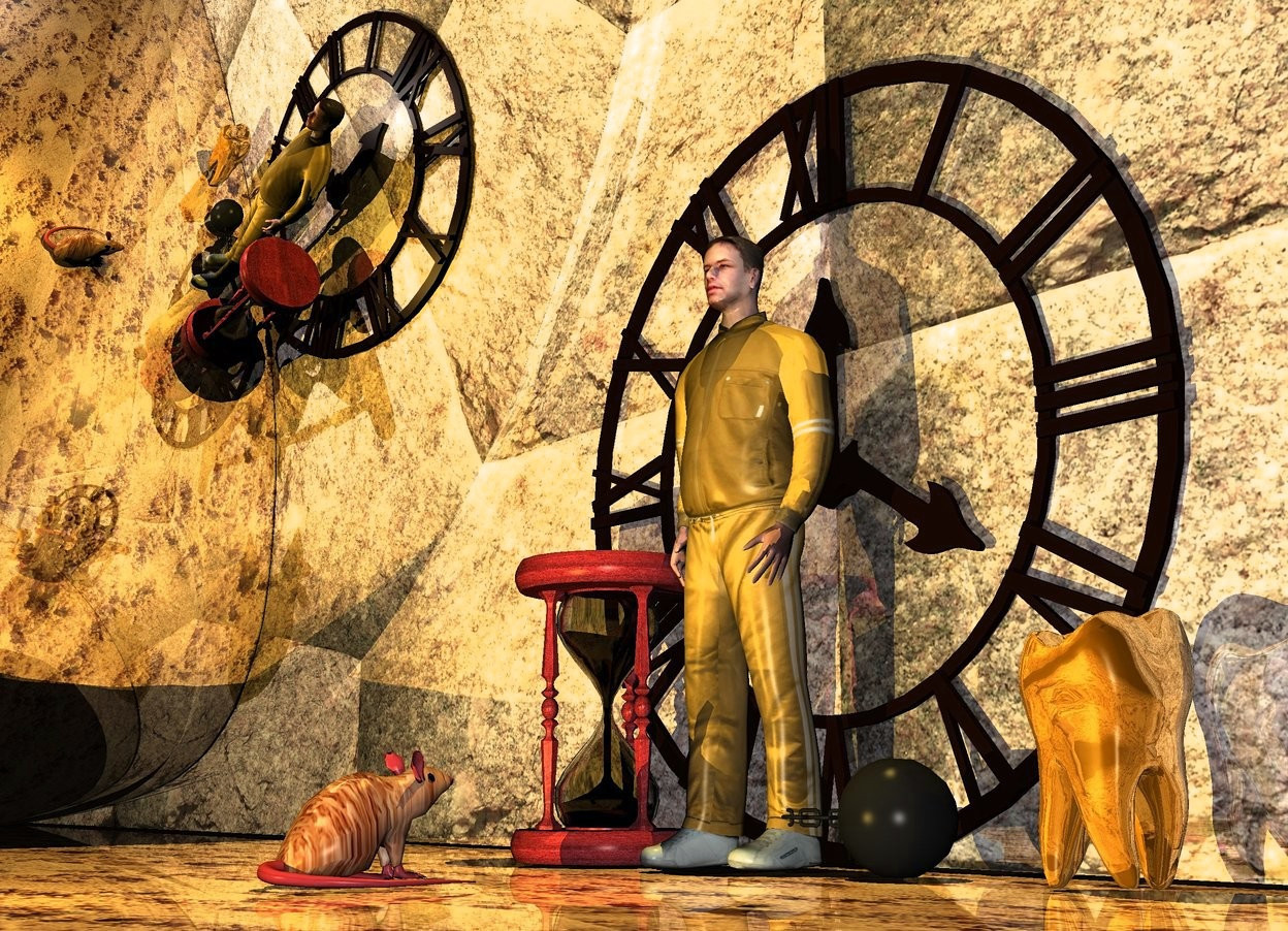 Input text: a ball and chain.a man is -8 inches left of the ball and chain.the man is -18 inches behind the ball and chain.a 3 feet tall hourglass is left of the man.a 8 feet tall clock is 6 inches behind the man.a 60 feet tall wall is behind the clock.it is night.the wall is rock.the ground is sand.a first 70% yellow light is 5 feet in front of the man.the man is khaki.a second 70% yellow light is 5 feet above the man.the ground is shiny.the wall is shiny.a 1 feet tall mouse is 2 feet in front of the man.the mouse is facing the man.the mouse is fur.the wall is 100 feet long.a 30 feet tall silver sphere is 1 feet left of the mouse.a 2 feet tall gold tooth is 1 feet right of the ball and chain.