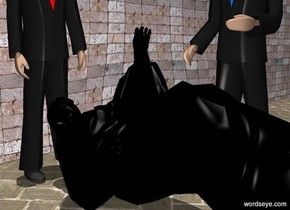 a face up black statue.a 1st man is right of the statue.the 1st man is facing the statue.a 2nd man is behind the statue.a flat wall is 1 feet behind the 2nd man.the wall is 50 feet long.it is noon.the wall is [brick].