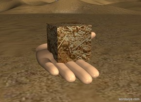 The huge hand is 4 feet above the ground. The [dirt] cube is 9 inches in the hand. The hand is leaning 90 degrees to the back.