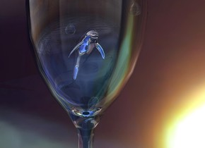 A silver dolphin fits in a large glass. It is facing southeast. A [dark] wall is behind the glass. The ground is shiny [water]. A blue light is above and left of the glass. A cyan light is right of the glass. Camera light is cream. A drop is right of and 0.4 inch above the dolphin. A drop is 2 inch left of and -1 inch above the drop.