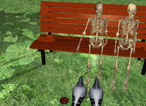 There is a bench.  In front of the bench is a first small skeleton. on the right of the first skeleton is a second small skeleton. The ground is grass. On the left of the bench is a tree. In front of the first skeleton are 2 doves facing it. On the left of the dove is a brown stone. There is a big light behind the bench.