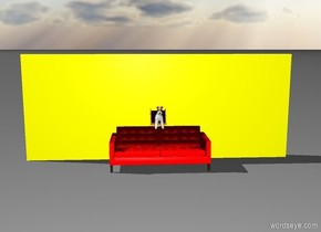 A yellow wall. A red couch in front of the wall. A dog is above the couch. A medium picture frame is above the couch behind the dog.