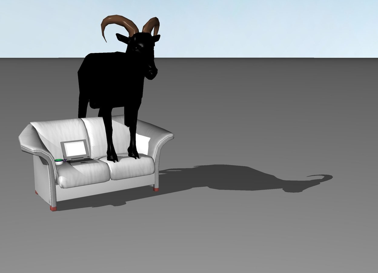 Input text: a black goat, a grey laptop and a cup on a grey sofa