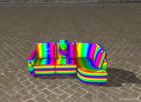 Rainbow cat on the Rainbow Couch