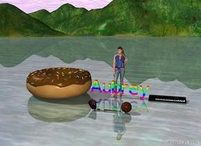 """rainbow """"Aubrey"""".  Gigantic donut beside """"Aubrey"""". Huge paintbrush 5 feet in front of """"Aubrey"""".  A basketball to the right of the paintbrush.  A glove to the left of the paintbrush. Instrument to the right of """"Aubrey"""". Girl behind """"Aubrey"""" Cow behind """"Aubrey"""" girl"""