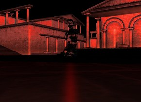 It is night. A white transparent sculpture. A red light is inside sculpture. Red light is 3 feet above ground.