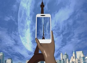 an eiffel tower. a 10 foot tall cellphone is 500 feet in front of the eiffel tower. it is 12 feet above the ground. the cellphone's display screen is [toureiffel]. a 18 foot tall hand is  -22.5 feet above and  -2 foot behind and -5 feet to the right of the phone. it leans 180 degrees to the left. it faces left. the background is city.
