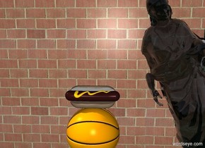 Large dark brown Hotdog on a big orange basketball in front of a brick wall with a leaning translucent statue