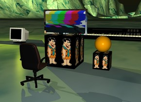 the orange sphere is on top of the [flintstone] cube. the large [flintstone] cube is 1 feet to the left of the [flintstone] cube. the [keith richards] monitor is on top of the large [flintstone] cube. the small chair is 2 feet in front of the large [flintstone] cube. the small chair is facing north. it is sunset. the yellow light is on top of the computer monitor. the huge huge keyboard is 12 feet behind the large cube.
