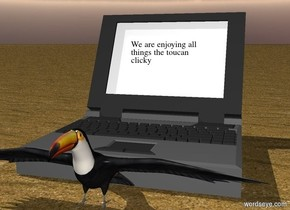 ground is sand. there is a large computer. toucan is in front of computer