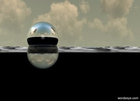 A clear sphere is in the sky. A silver sphere is in the sphere. The sky is black.