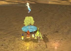 desert. a 7 feet tall tree 5 feet behind a 3 feet tall squirrel. 1 feet right of squirrel is 3 feet tall chicken. right of chicken is 3 feet tall lizard. 1 feet left of squirrel is 3 feet tall goldfish. yellow light is 10 feet in front of tree. pink light is 10 feet right of yellow light. 1 4 feet tall sun symbol 2 feet above tree.  8 feet wide oasis under tree.  one 5 feet tall angelina jolie 1 feet in front of sun symbol.