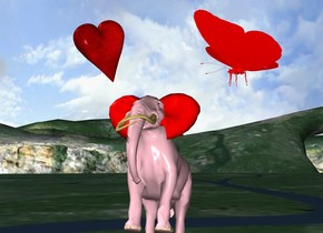 the large red butterfly is 3 feet above the ground. a tiny red heart is 6 inches to the left of the bug. the bug is facing left. the heart is facing southeast. it is leaning 20 degrees to the right.  the very tiny pink elephant is to the left of the butterfly. it is 1.7 foot above the ground. it is leaning back. the ear of the elephant is red.