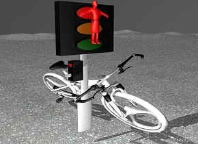 a 100 inch tall and 50 inch wide  traffic light.ground is pavement..a 50 inch tall and 70 inch wide and 180 inch deep white bicycle is -30 inch right of the traffic light.the bicycle leans 25 degrees to right.the bicycle is -120 inch in front of the traffic light.a 30 inch tall   red man is -29 inch above the traffic light.the man is 10 inch in front of the traffic light.a gray light is 30 inch in front of the traffic light.sky is dark gray.ground is 10 feet tall.the tire of the bicycle is white.