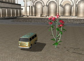 a klee car is on the ground seven feet to the left of the very enormous flower