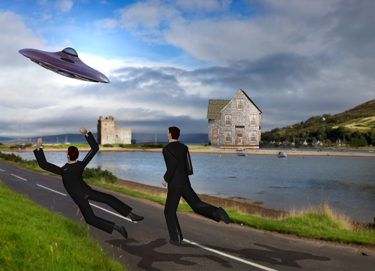Input text: a road backdrop. a shadow plane. a  man is right of another man. the small house is 60 feet behind the men.  the silver ufo is above and 20 feet left of the house. it is leaning left. the men are facing northwest.