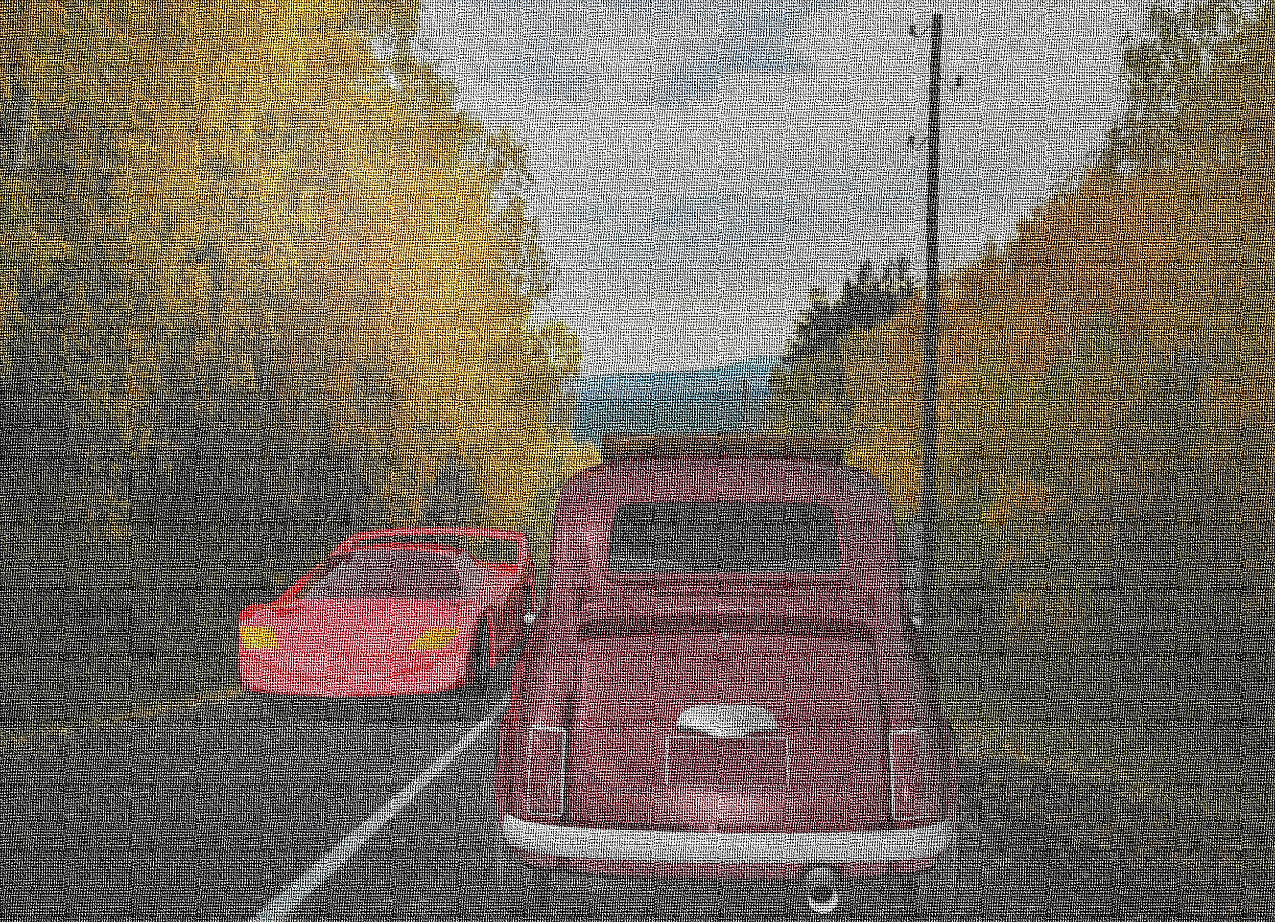 Input text: The first car is on the road. The first car is shiny red. There is a second car 2 feet in front of the first car. The second car is 2 feet to the right. The second car is facing the north