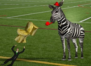 the [football] backdrop. The man. the large gold toilet is above and -4 feet to the right of the man. it is facing southwest. it is leaning 35 degrees to the left. the huge zebra Is 6 feet to the right and 7 feet behind the man. It is facing southwest. the enormous red whistle is 5  foot above and 5 feet to the right of the man. it is upside down. it is leaning 30 degrees to the right. The red hat is 4 foot above and 4 feet to the right of the toilet.it is leaning 35 degrees to the front.  It is morning.