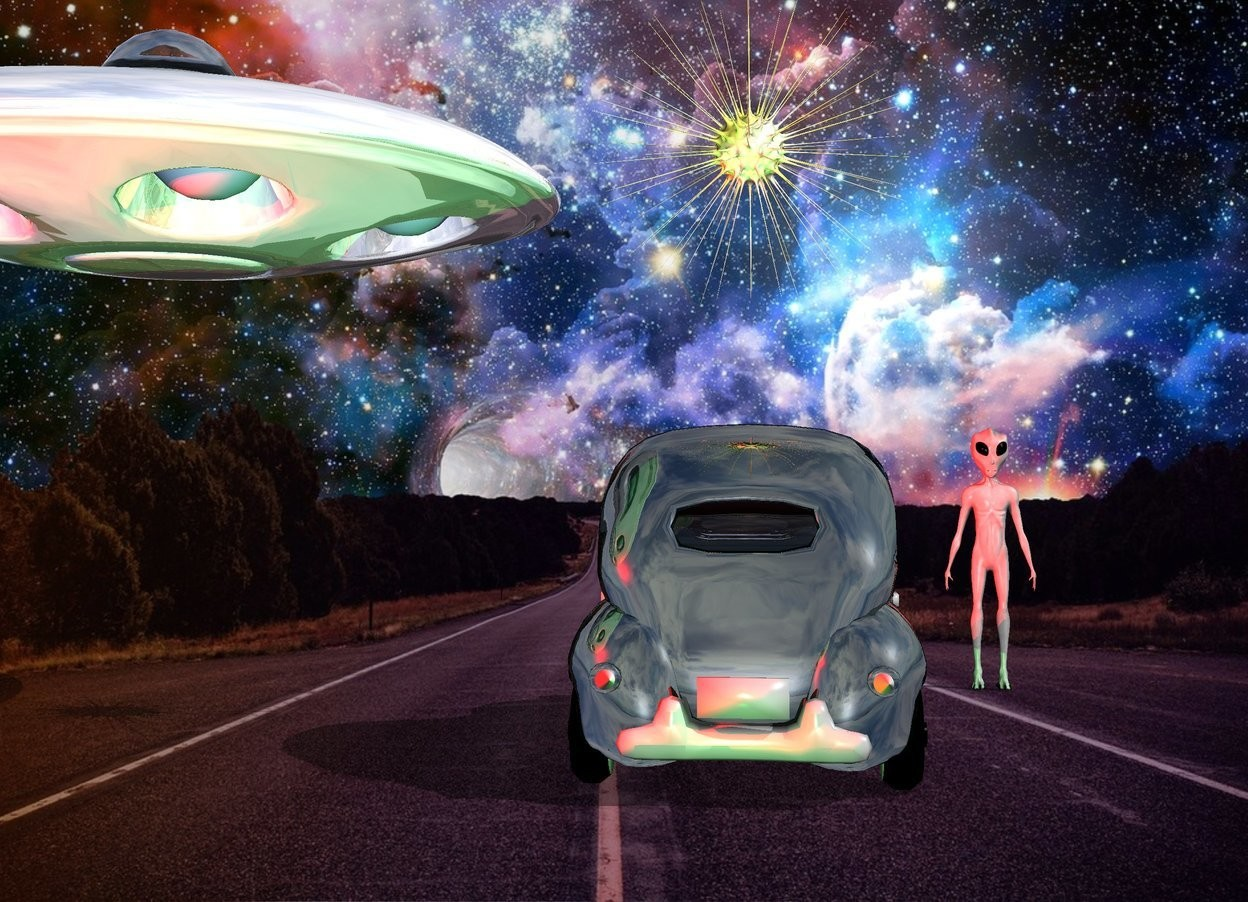 Input text: the fantasy backdrop.  a large sun symbol is 3 feet above the shiny car. a shiny UFO is 1 feet to the right and 4 feet above the car. the tall alien is 2 feet in front and 2 feet to the left of the car. he is facing back.   three red lights are 1 feet behind the UFO. a green light is 1 feet behind the car.