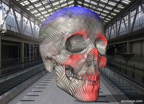 a 100 inch tall skull.the skull is 30 inch wide [steel].two maroon lights are in front of the skull.two blue lights are 150 inch above the skull.