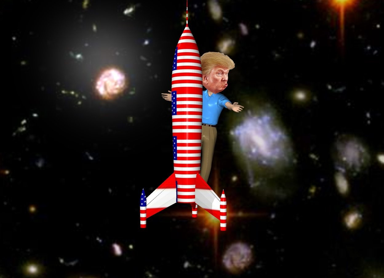 Input text: the sky backdrop. the man is behind the [flag] rocket.  he is leaning 10 degrees to the left. the head is -1.4 foot above and in front of the man. it is -4 feet to the left of the man. the rocket is 9 feet tall.