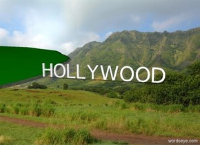 "There is a big green muddy hill. ""HOLLYWOOD"""