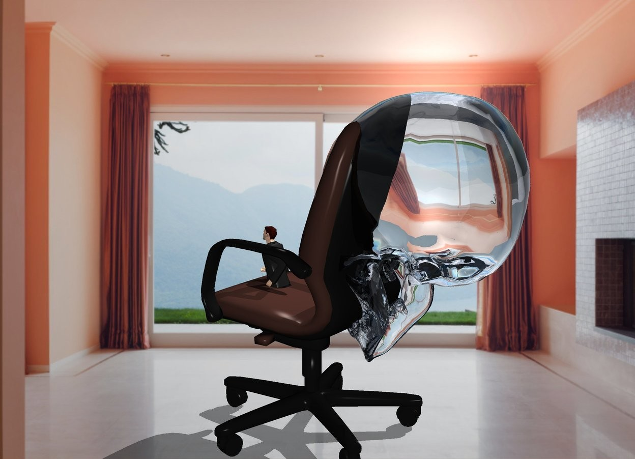 Input text: The  image  backdrop. a tiny business man in a chair. a  huge transparent skull is behind the man. a brown light is inside the transparent skull. a white light is above the man