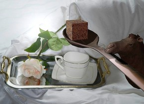 A [tea] spoon. [Tea] backdrop. A 0.8 inch high [sugar] cube is -0.5 inch above and -1.5 inch behind the spoon. Camera light is brown. A 6 inch high camel is -1 inch right of and -5.05 inch above the spoon. It is facing west.