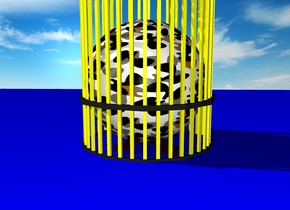 camouflage sphere in a yellow cage on blue blanket