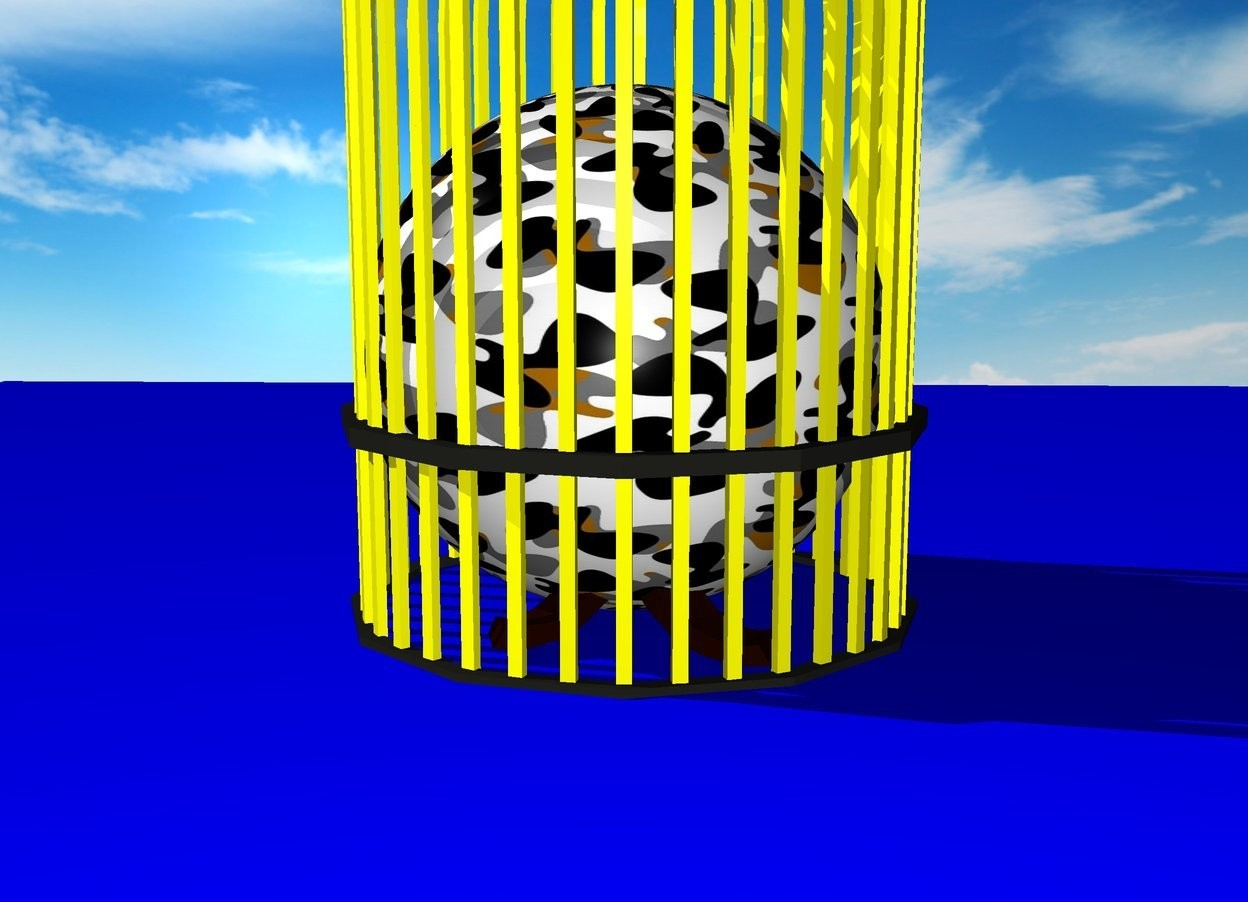 Input text: camouflage sphere in a yellow cage on blue blanket