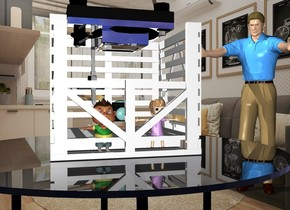 The room backdrop. The small white  box is on the table. The silver projector is -1.4 feet above the box. It is upside down. the silver turntable is -4 inches above the projector. It is upside down. The man is behind and 6 inches to the right of the table. He is facing the table. The kid is -4 inches in front and -11 inches to the right of the box. The kid is 9 inches tall. A 2nd kid is 1 inches to the left of the kid. She is 9 inches tall.