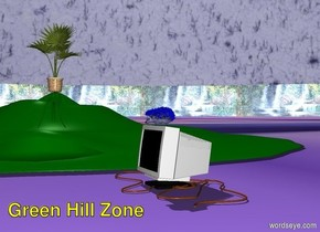 A Blue Hedgehog stands on a computer monitor on a green hill. A waterfall is in the background. Many Golden rings are beside the monitor in a line. The ground is checkered. There is a large geometric palm tree on top of the hill. The sky is blue and cloudy