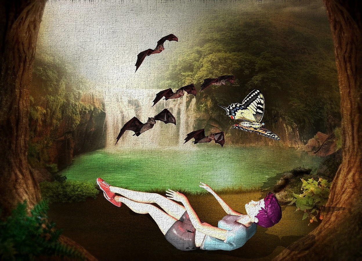 Input text: fantasy backdrop.a face up woman.a large bat is 7 inches above the woman.a red light is in front of the bat.a linen light is left of the bat.a giant butterfly is 2 inches in front of the bat.it is leaning 45 degrees to the left.