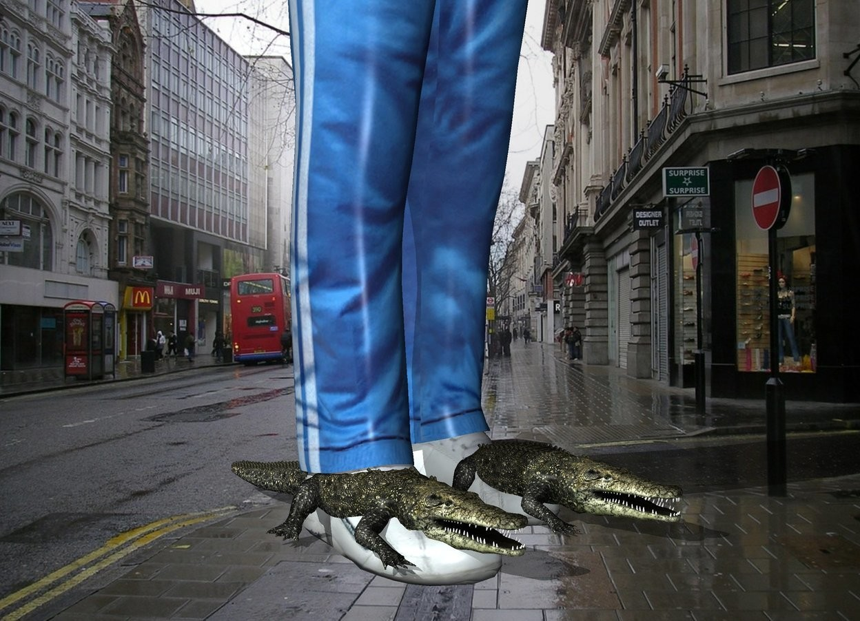Input text: the city backdrop. the man is -4.5 inches above the  very tiny crocodiles. he is 6 feet tall.